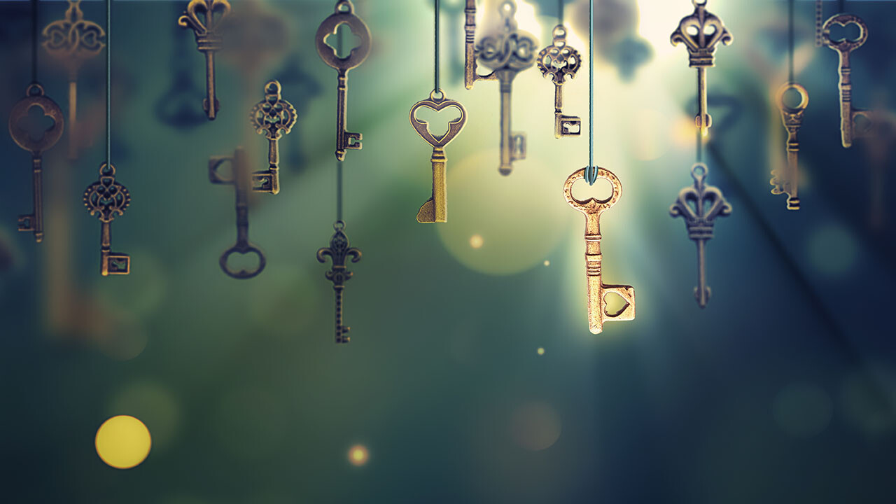 A conceptual image with hanging keys and one shining key.